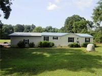 Well maintained double-wide on 4.5 acres in Delta