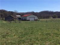10.94 ACRES, READY FOR HORSES 2 FENCED PASTURES. 36x45
