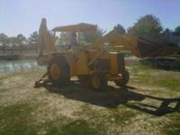 310 John Deere Backhoe with 3600 hours, ready for