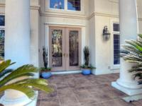 Stunning bayou front home in the desirable gated golf