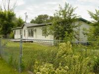 Exterior Features Home sits on a nice sized lot, mature