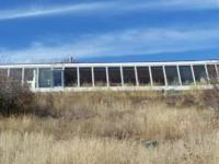 An earthship designed by Michael Renyolds, 3 bedrm 2