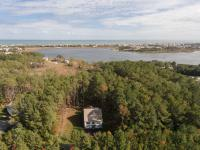 Two acres on the Salt Pond w/ private pier & custom