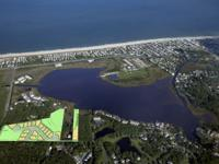 Two acres on the Salt Pond with private pier & custom
