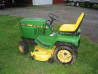 This tractor has a fresh motor , new paint , repaired