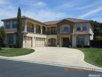 This beautiful custom home is located in a private