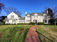 This classic home's grand features include formal