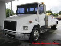 1999 FREIGHTLINER FL60, with ONLY 126,000 miles. It has