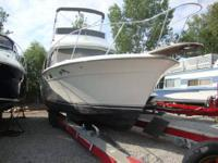Recently listed is a 1990 Trojan F32 flybridge boat