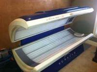 Sunstar 32 bulb tanning bed with 3 face lamps. Bulbs