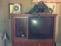 32 inch RCA television and cabinet it fits perfectly in