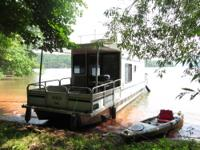 Call Boat owner Ken . Houseboat, gas grill, sleeps 3
