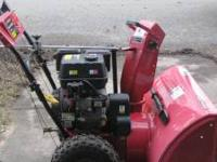 "Powerland dual-stage snowblower. Cuts a 32"" path with a"