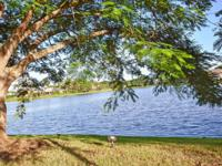 Situated on a 0.46 acre lakefront lot is the grand