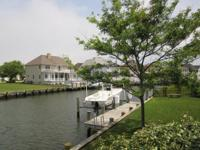 Large Bay front corner lot home on the south side of