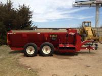 THE TOP SHOT SIDE DISCHARGE MANURE SPREADER HAS A 2000