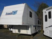 1994 Prowler 5th wheel camper. Living/dining and bed
