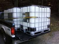 Washed clean! 275 gallon tote tank Container. Plastic