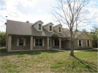 The 4 bedroom/ 2 bathroom beautifully built brick home
