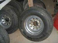 HAVE A SET OF FOUR DUNLAP 33X12.X16.5 ON CHROME RIMS 8