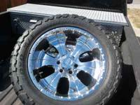 (4) toyo m/t mounted on chrome 20 inch American Racing