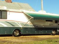 Beautiful 36 ft. motor home with a super slide,powered