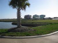 Enjoy fishing off this corner waterside lot in the Bay