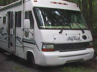 Richly appointed, full size (34'), wide-body motor home