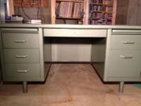 This double pedestal desk is in really good condition.