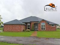 Wonderful 5/3/2 on 10 flat acres with some large trees.