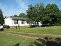 Immaculate doublewide situated on a beautiful and