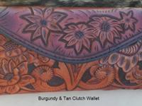 This hand tooled burgundy and tan clutch wallet is