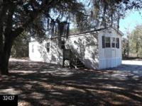 Private woody lot with a front end kitchen area.