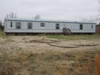4 bedroom mobile home with 1/2 acre lot for sale -