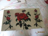 This is a beautiful red rose 3 piece mirror set. The