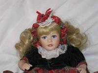 Cassidy Tiny Tot is a porcelain Marie Osmond doll. She