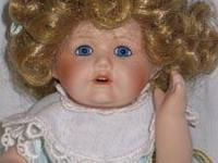 Melissa is a porcelain Marie Osmond doll from the