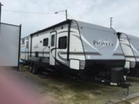 2016 310 DS Pioneer travel trailer Queen bed in front,