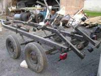 Boat trailer. has rollers and is a 2 axle tailer (4