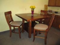 This is a heavy cherrywood table with a granite (or