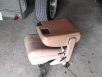 Tan leather jump seat out of a 01 F250 Lariat edition