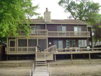 Large well maintained lake front home. Enjoy 60 feet of