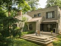 This home rests on two acres of park-like splendor on a