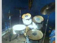 Pulse five piece drum set for sale. Its white and