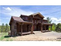 Gorgeous log house on 3.7 acres with adjacent 7.9 acres