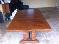 This dark hardwood table is in great condition with