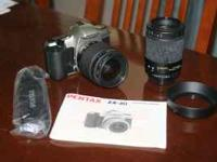 Pentax ZX-30 SLR 35mm film camera. Comes with Promaster