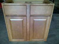 This cabinet is a gunstock color with 2 drawers and 2