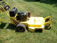 36 inch walkbehind lawnmower 14 hp honda. never used