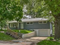 The home at 3630 Jackson St, St Joseph, MO is a three